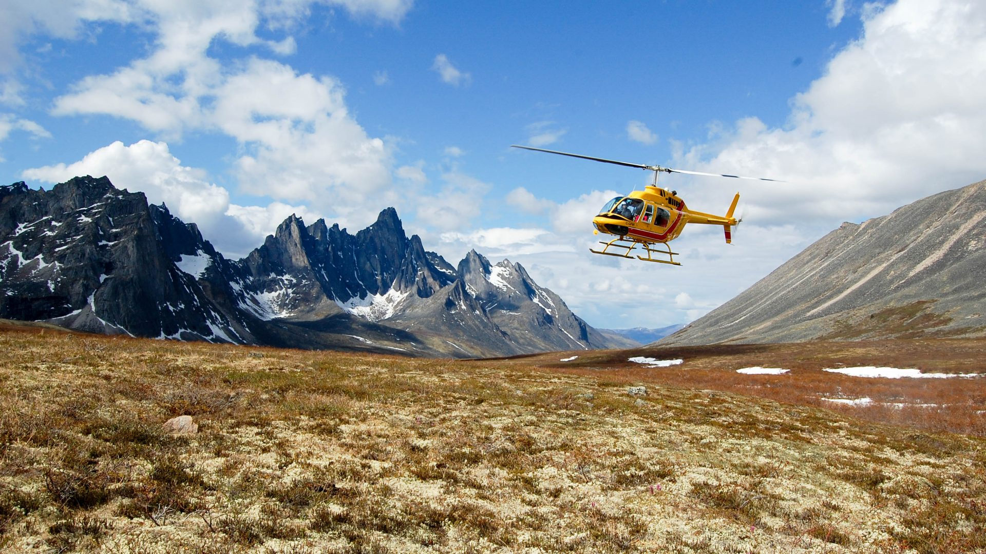 Explore Remote Valleys -Trekking Tombstone Mountain - transfer with helicopter