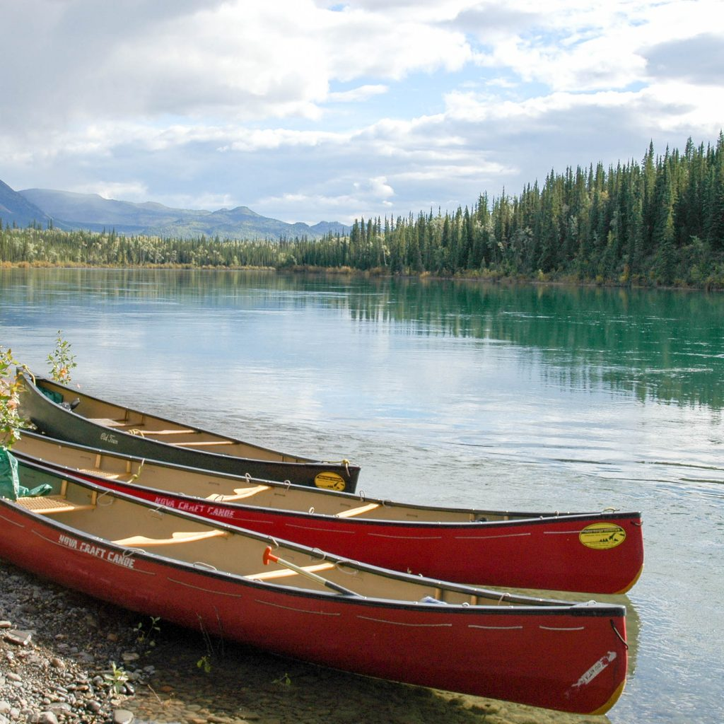 Yukon River Tour - Lake Laberge to Carmacks - Canoe next to the Yukon River